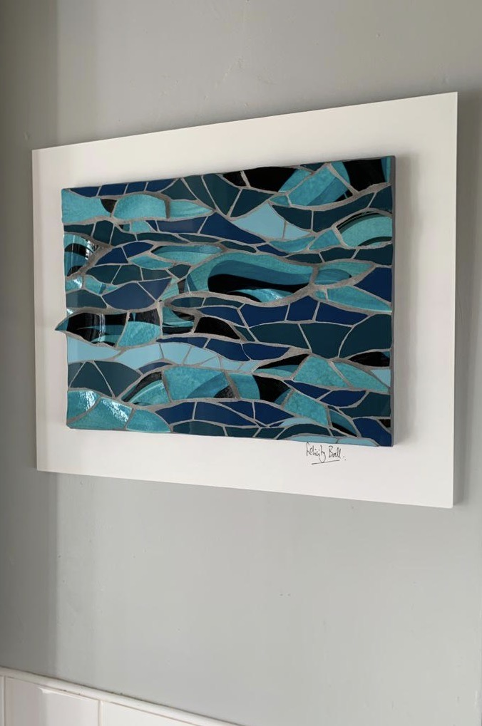 Wave mosaic made from a broken plate