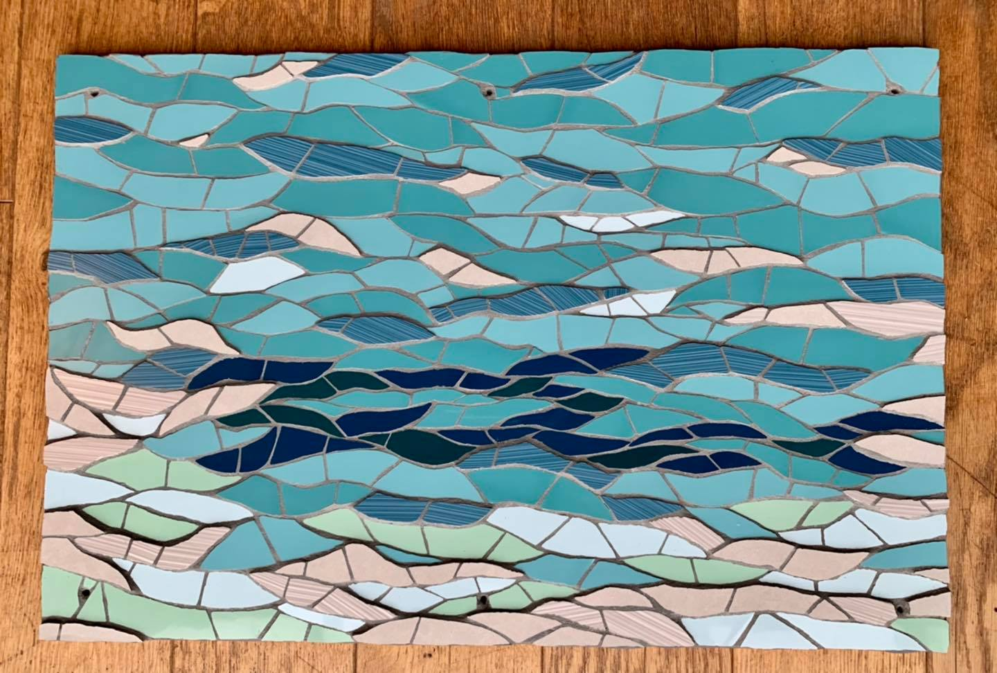 Seascape mosaic for a bathroom